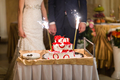 Bride And Groom With Cake  At wedding Reception