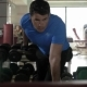 Man Exercising With Dumbbell In The Gym