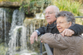 elderly couple and a waterfall