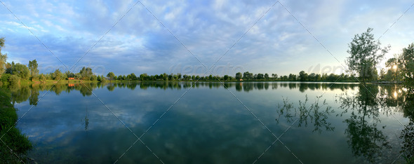 Panoramic view of a lake at spring  - Stock Photo - Images