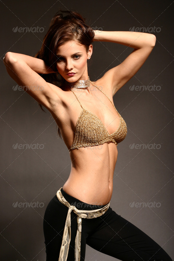 Sexy woman in golden bikini top - Stock Photo - Images