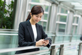 Businesswoman use of cellphone for sending message