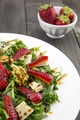 Spring salad with strawberries, rocket salad, parmesan cheese, w