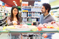 Couple shopping in a grocery store