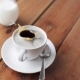 Sugar Falling Into Cup Of Coffee On Wooden Table 43