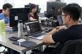 Asian Outsource Developer Team Sitting At Desk Working Laptop