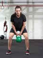 Young man exercising with kettlebell