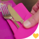 Waiter Setting Cutlery On Table In Restaurant