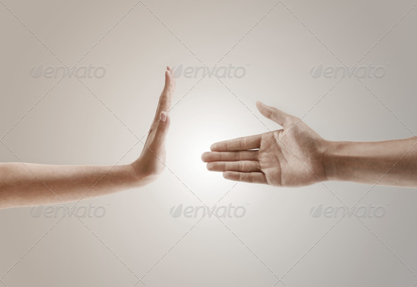 hand gesture concept of one hand refusing to handshake - Stock Photo - Images
