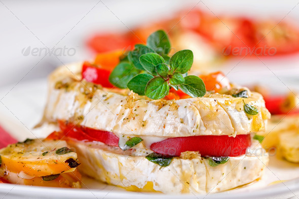 Cheese with white mildew marinated with garlic - Stock Photo - Images