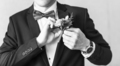 Wonderful wedding boutonniere on a costume of groom close-up