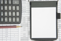 Notepad and brown pencil with calculator on finance account