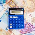Financial concept. Euro money. Euro notes with calculator