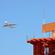 Radar Telecommunications Tower and Airplane Taking Off