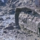 Caterpillar Excavator Moves on a Dirt Offroad