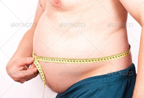 PhotoDune Fat man holding a measurement 1589530