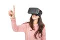 asian woman wearing virtual reality goggle