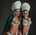 Sexy beauties posing in costumes for erotic dance