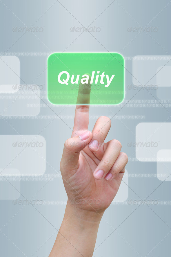hand pushing quality button on a touch screen interface  - Stock Photo - Images