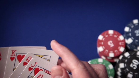 Download Royal Flush In Hand And Gambling Chips On Casino Blue Felt nulled download