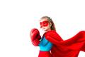 Superhero kid wearing boxing gloves Isolated on white background.