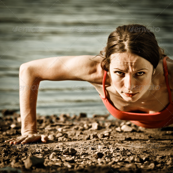PhotoDune Strong woman doing pushup 1595241