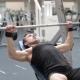 Man Bench Pressing Weights