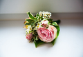Groom's boutonniere of roses