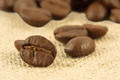 Macro shot of coffee beans scattered on mat - PhotoDune Item for Sale