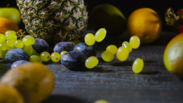 Download Grapes Falls And Splatters On Table With Fruits nulled download