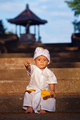 Portrait of balinese child in traditional costume - Sarong