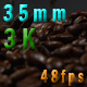 Coffee beans falling on a black table 32