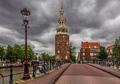 Montelbaanstoren tower under cloudy sky in Amsterdam, Netherland