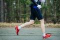 closeup of feet runner men