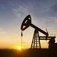 Silhouette Of Crude Oil Pump At Sunset In Oil Field - 1