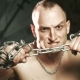 Young Bald Man Trying To Thorn The Metal Chain