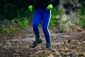 legs girl athlete running on mountain trail of stones