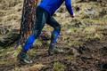 legs male athlete running uphill
