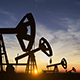 Silhouette Of Crude Oil Pump At Sunset In Oil Field - 8