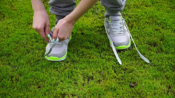 Download Girl Stopped Running To Tie The Laces On Running Shoes. Fitness Girl Training Outdoors nulled download
