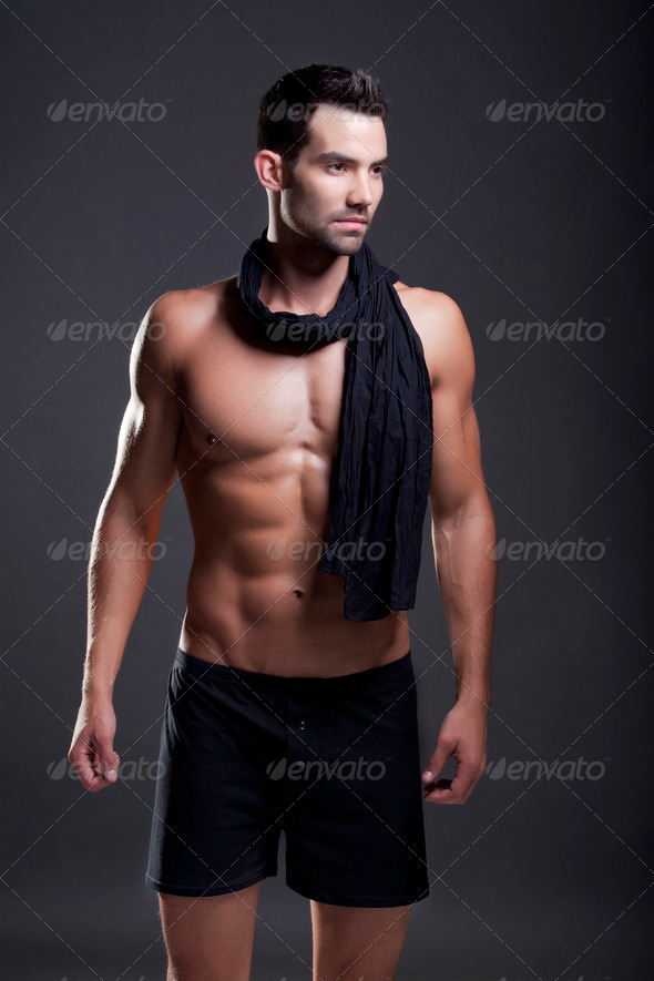 Closeup of a muscular handsome man in underwear - Stock Photo - Images