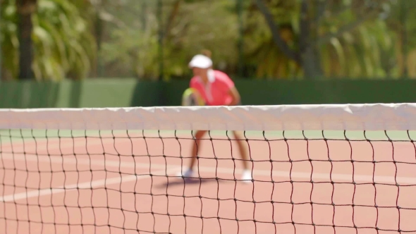 Download Athletic Shapely Woman Playing a Game Of Tennis nulled download