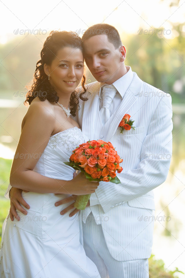 Bride and Groom smiling outdoors - Stock Photo - Images