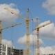 Construction Cranes Against  Sky
