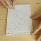 Human Hands With Pencil Draws In Notebook On Wooden Table