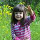 Little Girl Playing With Dandelions