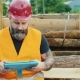Brutal Builder Or Worker Uses a Tablet In a Break From Work
