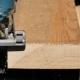Man Sawing Plank Electric Fretsaw