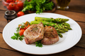 Barbecue grilled beef steak meat with asparagus and tomatoes.