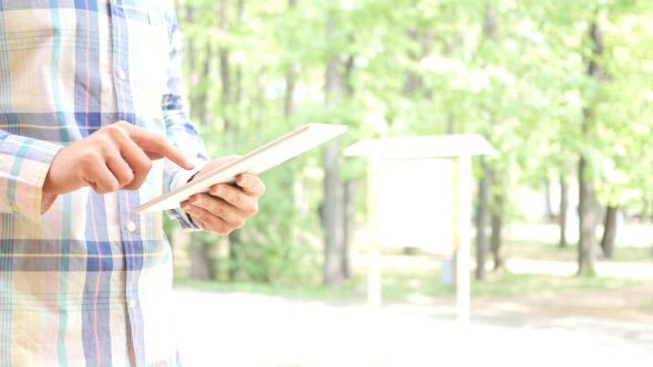Man Typing on Touchpad, Standing Ulkona - Technology Arkistofilmit